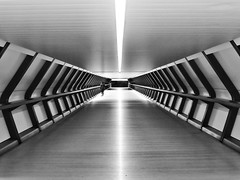 Skywalker (Douguerreotype) Tags: canarywharf geometric futuristic london blackandwhite symmetry monochrome people docklands british uk mono geometry city architecture britain urban gb bw england