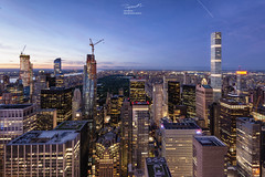 Skyline of Manhattan and Central Park during Blue Hour (tapanuth) Tags: aerial america architecture attraction bluehour bluesky building business centralpark city citylights cityscape construction destination downtown dusk evening famous famousplace highrises hudsonriver landmark manhattan midtown modern new newyork night northamerica nyc observationdeck office park river rockefeller skyline skyscraper sunset topoftherock tourism tower travel twilight unitedstates uptown urban us usa view york