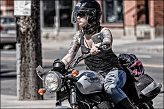 Triumph Girl on Bank Street (Dan Dewan) Tags: 2018 canonef70200mmf14lisusm portrait bankstreet street people person canon colour ottawa june sunday motorcycle triumph woman tattoo ontario canada glasses girl dandewan lady