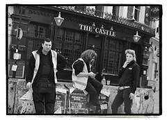 THE SMOKERS GUARDING THE CASTLE. (StockCarPete) Tags: london uk londonstreets smokers farringdon thecastlefarringdon concreteblock workers hivisjackets bw billstickers