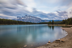 Quiet Time (zachary.locks) Tags: alberta area banff blue ca canada capped clear cloud clouds curve edge exposure green jack lake leading lines long mountains movement mt national park pinic rundle shore sky snow still trees two water zlocks