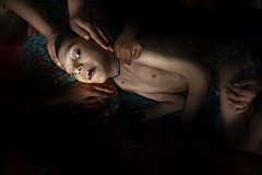 A Bhopal story (silvia.alessi) Tags: emotional suffering travel people disaster unioncarbide asia light face hands dramatic bhopal ngc children
