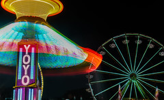 yo yo spinning down (pbo31) Tags: sanmateocounty bayarea california nikon d810 color june 2018 boury pbo31 sanmateocountyfair sanmateo night dark black butleramusements spinninglight fair midway carnival ride lightstream motion spin motionblur blue ferriswheel yoyo swings