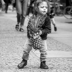 heavy weight (every pixel counts) Tags: 2018 berlin street kid eu capital city prenzlauerberg bw square 11 ananas fruit day kollwitzplatz rue everypixelcounts blackandwhite blackwhite people germany cobblestones daylight