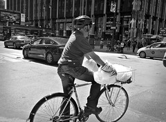 Uncomfotable Ride (Robert S. Photography) Tags: man riding street cross bw monochrome manhattan msg west33rd ciy newyork spring scene signs people sony dscwx150 iso100 may 2018