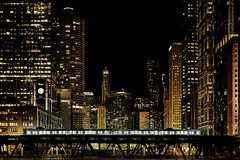 The Night's Last El (Carl's Captures) Tags: wellstreetbridge basculebridge chicagoillinois cityofchicago cityscape night evening skyline architecture cta chicagotransitauthority transportation commutertrain masstransit ltrain eltrain cookcounty downtown theloop chicagoriver urban thewindycity june summer vista coaches carriages crossing mood motion story chitown tracks rails nelsonalgren novel author nevercomemorning towers blur whoosh nikond7500 sigma18300 photoshopbyfehlfarben thanksbinexo