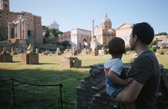 a toddler in italy, part two (manyfires) Tags: analog film henry toddler boy child son italy europe travel vacation rome nikonf100 35mm father dad michael bokeh romanforum forum forumromanum fororomano pantheon temple church jetlag stroller