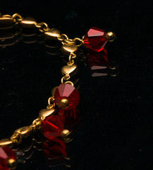 _1230871-1230875 (wiccan_two) Tags: gold jewelry apperal shiney black metal reflection bracelet ruby gem gemstone jewel hearts heart hdr