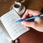 Writing in notebook with blue pentel quicker clicker mechanical pencil thumbnail