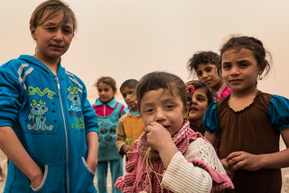Children of Irak in a refugee camp. Love in blue.