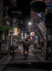 Taipei cycler (reinaroundtheglobe) Tags: taipei taiwan asia streetphotography streetlife dark nightphotography night cycler 1person streetlight advertisement