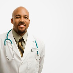 Male doctor smiling. (perfectionistreviews) Tags: color indoors square onepersononly halflength africanamerican medical male midadultman 2530years hospitalworker whitecollar professional profession uniform physician doctor posed studioshot occupations medicalpractitioner eyecontact portrait smile smiling copyspace photograph scienceandtechnology healthcare
