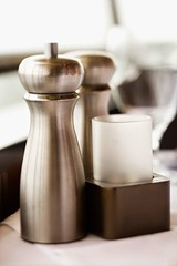 Salt and pepper shaker. (perfectionistreviews) Tags: image photograph color colour nobody vertical stilllife indoors salt pepper table dinner taste food condiments condiment flavor candle restaurant foodanddrink