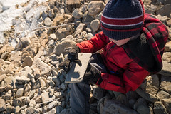 Boy sitting on rocky shore of lake in Ontario winter (blurMEDIA Stock) Tags: brucepeninsula canada earth georgianbay ontario child childhood climate climatechange cold conservation environment etching exploring fossil fragile freezing frozen globalwarming ice icy inscribe lake lakeshore landscape learning melt melting memorial outdoor phasechange planet preservation rock shoreline solitary solitude spring springthaw stewardship thaw warming water wilderness winter winterjacket