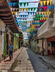 Getsemani Streets (Packing-Light) Tags: cartagena colombia nikon southamerica getsemani flags street colorful shadows day lines geometry
