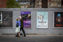 The Conductor (Leanne Boulton) Tags: people sign urban street candid streetphotography candidstreetphotography streetlife man woman male female couple love romance together music banner billboard wall poster graffiti sillystring fun humour juxtaposition tone texture detail depth naturallight outdoor light shade shadow sunlight city scene human life living humanity society culture lifestyle art canon canon5d 5dmkiii 70mm ef2470mmf28liiusm color colour glasgow scotland uk