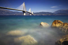 Rocks and Blues v2 (Bo.Th) Tags: bridge blue sky sea sun stone seaside seascape structure stones silhouette water waves weather colors clouds coast rocks rock light dreaming greece