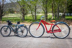 "Check out the wheels on the red bike!  You don't realize it until you put it next to a regular bike.  Amanda's green Surly has 26"" wheels."