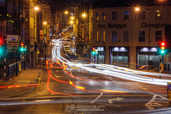 Late night traffic (mythicalireland) Tags: light trails traffic cars vehicles headlights st marys bridge shop street town buildings streets streetscape townscape long exposure