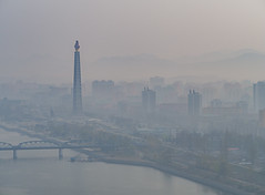 Misty morning in Pyongyang (TeunJanssen) Tags: pyongyang mist misty dprk korea northkorea juchetower river view skyline olympus omd omdem10 travel worldtravel traveling tower ypt youngpioneertours backpacking asia yanggakdointernationalhotel yanggakdo taedong