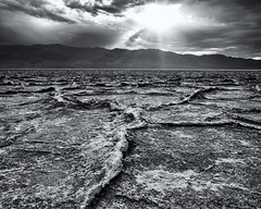 Death Valley - Badwater Basin - Big Salt Flat Line Leading to Sun - B and W (ImNotDedYet) Tags: saltflats badwaterbasin deathvalley deathvalleynationalpark sun clouds desert california blackandwhite