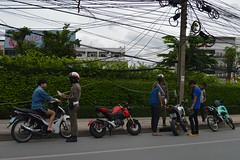 your tax money at work (the foreign photographer - ฝรั่งถ่) Tags: traffic police officers ticket books motorcyclists laksi circle bangkhen bangkok thailand nikon d3200