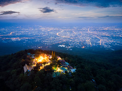 Aerial view of Wat Phra That Doi Suthep Temple at sunrise on the top of Doi Suthep mountain in Chiang Mai, Thailand. (MongkolChuewong) Tags: aerial aerialview ancient architecture asia asian background buddha buddhism buddhist chiang chiangmai church culture decoration destinations doi drone famous gold golden holy landmark lanna luxury mai monastery pagoda peace phra place religion religious sky spirituality stupa style sunrise sunset suthep temple thai thailand that tourism tourist traditional travel wat worship changwatchiangmai th