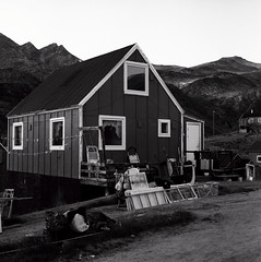 Kuummiit house (Úlfur Björnsson) Tags: b black white bw greenland trip traveling ilford dusk sunset mamiya kuummiit medium format film c220 80mm f28 sekor hp5 plus iso 400 houses house town