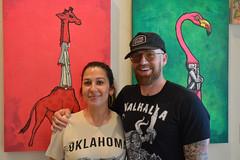 Laura and Dustin (radargeek) Tags: paseoartsfestival paseodistrict oklahomacity okc 2018 may festival bombsawayart illustrator artist beard couple giraffe flamingo painting art portrait tattoo tattoos hat