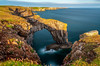 Green Bridge (absynth100) Tags: rocks cliff sea seascape wales water grass reflections sky clouds calm landscape