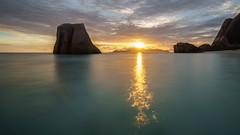 Barcardi Beach Sunset (Migge88) Tags: sonnenuntergang sunset sonne sun meer sea wasser water felsen rocks seychellen seychelles la digue langzeitbelichtung landschaft landscape blau blue wolken clouds abend alpha 6500 sony praslin gelb yellow himmel sky