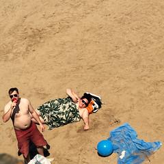 Man, Woman and Blue Ball. (stevedexteruk) Tags: sand beach seaside sunbathing wales coney coneybeach porthcawl 2018