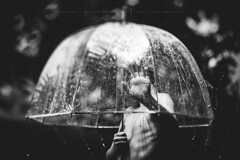 Mom, this water is COLD..... (privizzinis passion photography) Tags: blackandwhite people boy child children childhood outside outdoors outdoor water summer sprinkler umbrella freelensed freelensing light lighting