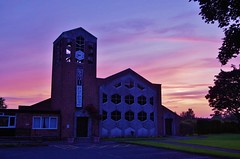 Against a colourful sky (Sundornvic) Tags: sky sunset glow clouds trees church churches tower spire silhouette