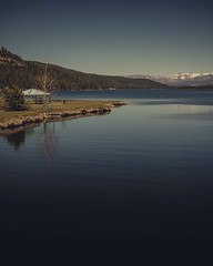 A dramatic view of a snow mountain from Donner Lake. (pedferr) Tags: horizon sunny water landscape sunset sunrise nature reflection vertical usa unitedstatesofamerica lake 4x5 snow bluesky morning blue colorful warm summit river summer sky outdoors california mountain forest hill dramatic