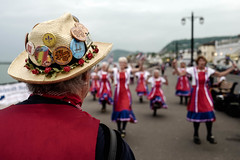 The Sidmouth Strollers... (Time to try) Tags: sidmouth devon uk england clogs clog clogdancing dancing red sea seaside esplanade leica leicaq prime fixed accordian hat morris bokeh focus light badge straw