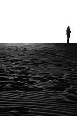 lady on the moon (bernard suen) Tags: dubai analogue nikon zoomlens film negativefilm 135film blackwhite bnw monochrome desert analoguephotography