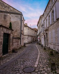 Day 774 - This is Rue des 3 Four at dusk. It's one of the first streets Savannah and I take to reach center Angoulême. The street is part of Old Angoulême and has been walked on at least as far back as the end of the Roman Empire (3rd or 4th century). We'