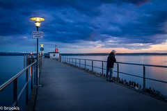 Watching the Sunset (brookis-photography) Tags: bluehour sunset pier lakeconstance water clouds