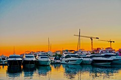 Orange is the new blue - Limassol sunset, Cyprus (Andreas Komodromos) Tags: boat colorful cyprus destination eu europe greek greekcypriot island limassol marina mediterranean photography sea seafront ship sky sunlight sunset travel vacation water waterfront waterway yacht reflections nyandreas vessel canal pier sunshine