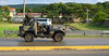 Jamaican Soldiers (Poocher7) Tags: people portrait soldiers army jamaicansoldiers armyjeep camouflage machineguns bulletproofvests helmets driving highway mountains fence