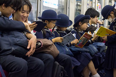 Going Home From School, Tokyo (Ray in Manila) Tags: japan tokyo train eos650d ef50mm schoolchildren hats books kids uniform culture mask people children girls boys sitting