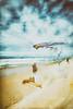 Un vent de révolte (Fabrice Le Coq) Tags: mer vent sable vague ciel nuages plage océan vacances flou silouhète bleu jaune