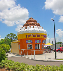 Anyone for an Ice Cream Cone, Twistee Treat, Pinellas Park, Florida (gg1electrice60) Tags: icecreamcone twisteetreat icecreamconebuilding architecture artdeco vendor treatstore treatstand parkinglot colorful drivethru drivethrough pinellaspark pinellascounty florida fl unitedstates usa us america 49thstreet fortyninthstreet fourtyninthst driveup tables umbrellas outsidebenches spotlights outsidelighting grabacone stand themedicecreamstand sweets usroute19n us19 nearfreedomlakepark nearbilljohnsonssportinggoods locatedonmainlandsboulevardw locatedonmainlandsblvdw cars