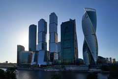 May 25, 2018 (pavelkhurlapov) Tags: skyscrapers architecture backlit sunlight river boat buildings cityscape sky water city tree skyline moscowcity
