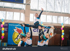 Kamenskoye, Ukraine - March 9, 2017: Championship of the city of Kamenskoye in cheerleading among solos, duets and teams, young cheerleaders perform at the city cheerleading championship (ig_royal6969) Tags: woman child sport dance young cheerleader female team cheerleading pompom teenager athlete cheerful costume performing supporter smiling uniform group happy cheering victory dancer jumping teamwork unity match editorial competition league action game indoor championship jump professional stadium arena college cup dribble girls power score tournament acrobat solo duet ukraine sale shutterstock