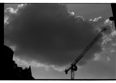 P63-2018-024 (lianefinch) Tags: argentique argentic analogique analog monochrome blackandwhite blackwhite bw noirblanc noiretblanc nb grue urban urbain city ville street rue cloud nuage sky ciel contrast