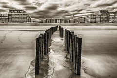 Knokke -13- (Jan 1147) Tags: beach strand zand sand gebouwen building monochrome monochroom sepia knokke belgium