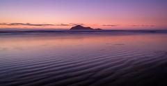 Echo Waves (ajecaldwell11) Tags: xe3 sunrise ankh purple water fujifilm light longexposure blue tide newzealand waimarama pink bareisland sky waimaramabeach hawkesbay caldwell clouds dawn