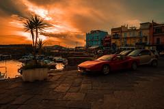Ferrari sunset..... (Dafydd Penguin) Tags: red ferrari sunset sun sey harbour port town urban car parking water sea pozzuoli italy naples napoli quay quayside harbourside harbor dock leica m10 elmarit 21mm f28